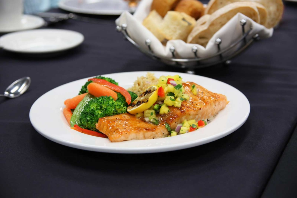 Catering by Norris delivers amazing meals for parties, weddings, dinners and all social occasions, Grilled Salmon Chermoula with steamed vegetable medley and rice