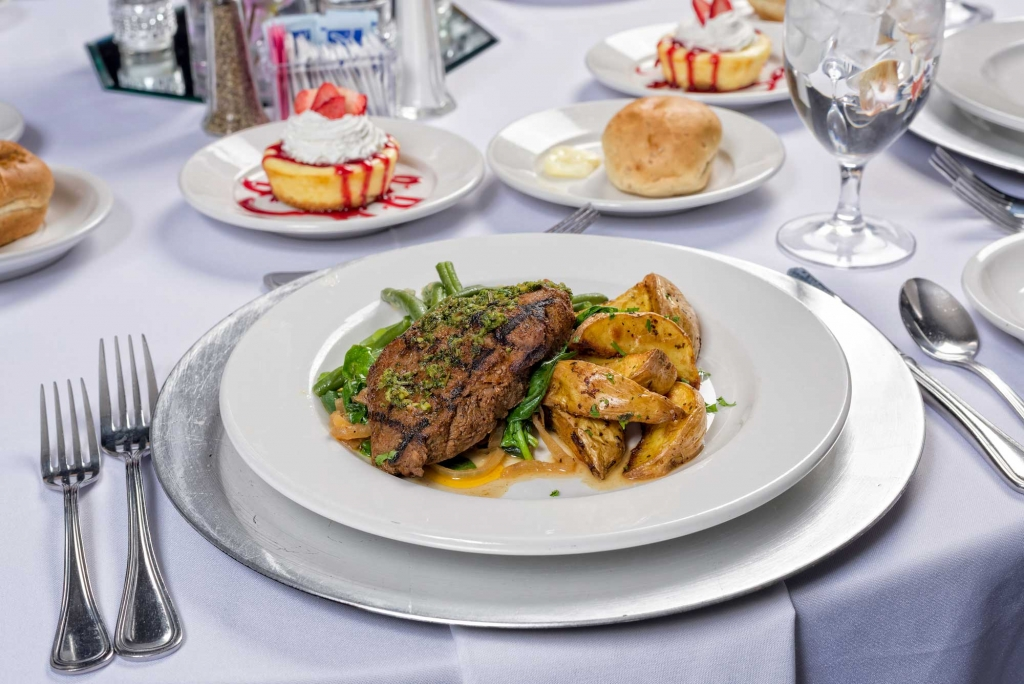 Catering by Norris delivers amazing meals for parties, weddings, dinners and all social occasions, New York Strip with green beans and wedge potatoes