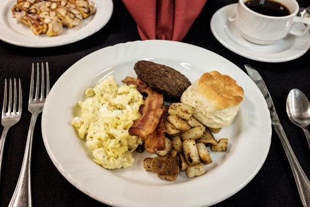 Catering by Norris serves up a Country Breakfast with scrambled eggs, roasted potatoes, bacon, sausage and a fresh biscuit
