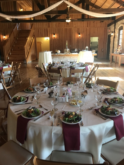 A Barn Setting Wedding with preset salads and dinner buffet by Catering By Norris
